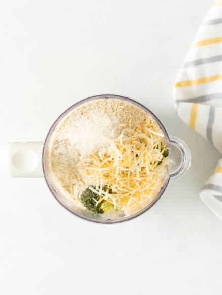 Blender with cheese, broccoli, sweet potato, seasonings, eggs