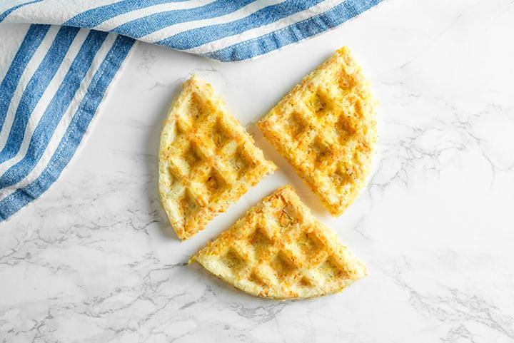 Waffles cut up into threes on a counter