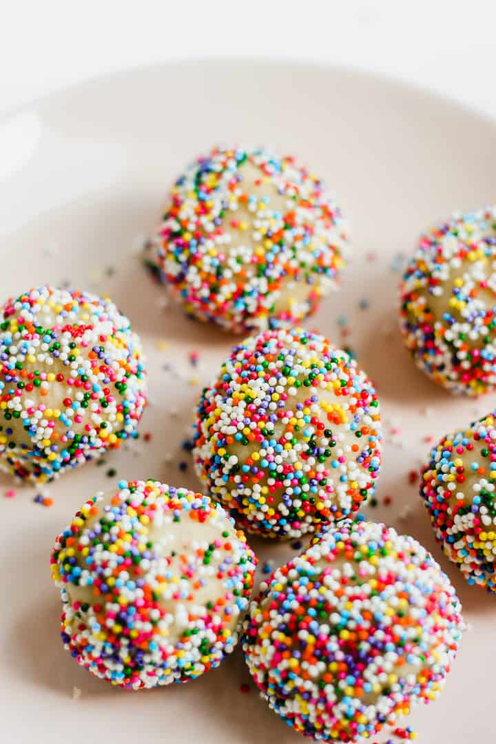 close up of cookie bites with sprinkles on a plate