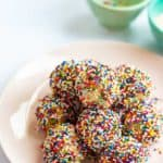 plate of cookie dough bites with sprinkles on a plate