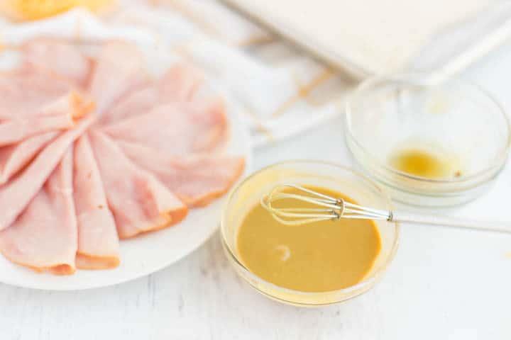 Dijon mustard on bowl, deli ham