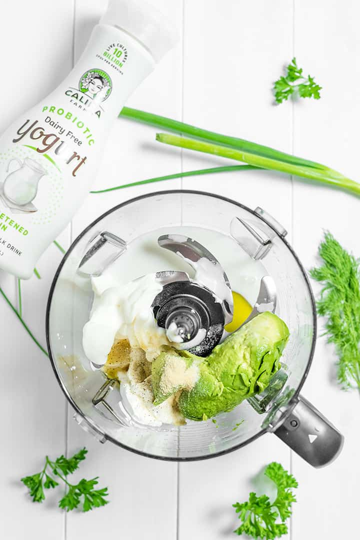 Avocado and ingredients in a food processor