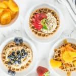 plates of waffles with delicious toppings