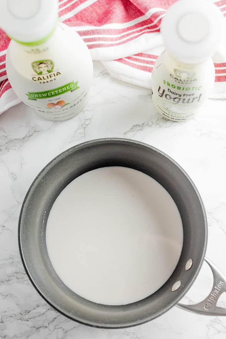 Small saucepan filled with almond milk, agar agar