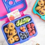 Purple and Pink lunch box with food inside