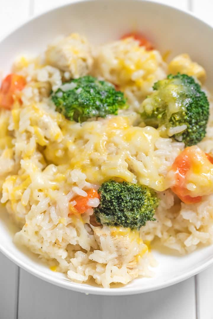 Close up of cheesy broccoli rice and chicken