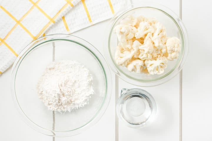 Bowls of water, flour and cauliflower