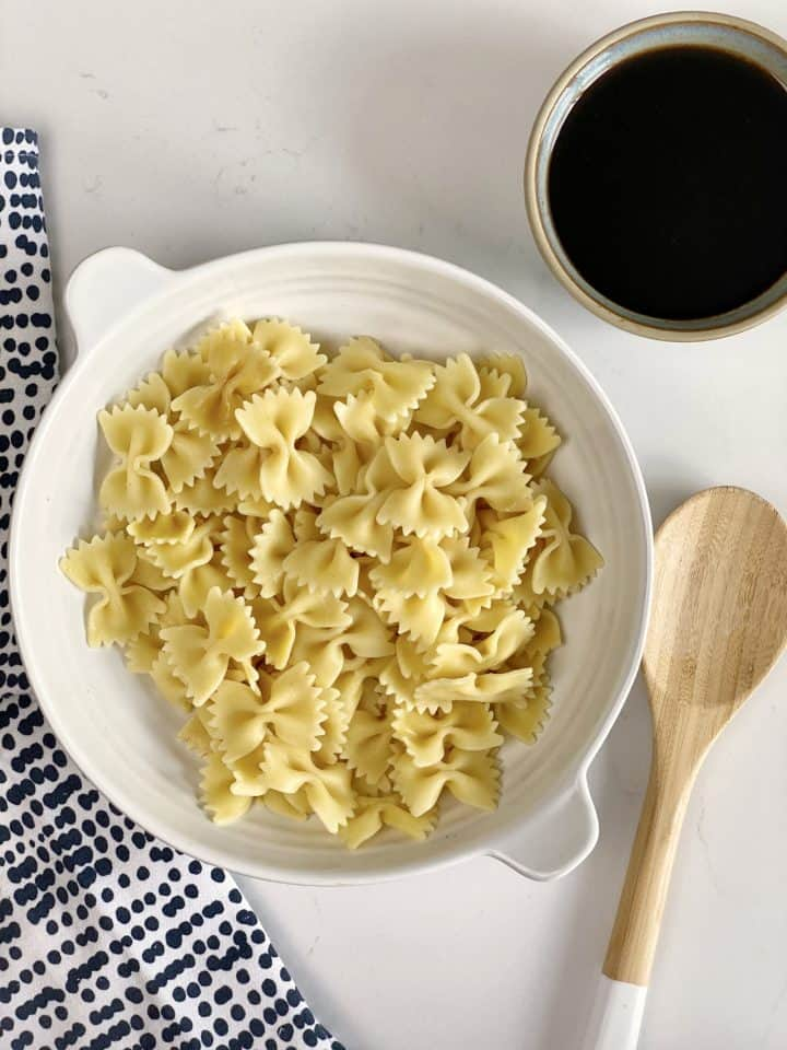 Cooked bow tie pasta in a bowl