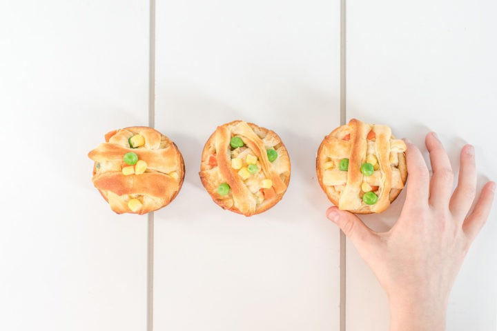 3 Chicken pot pies with kids hand holding one