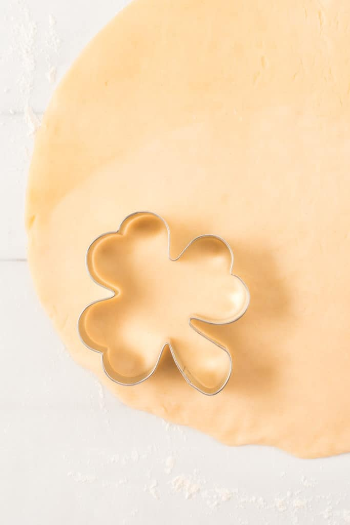 Shamrock cookie cutter on top of pie crust dough