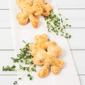 Shamrock hand pies on a white plate with garnish