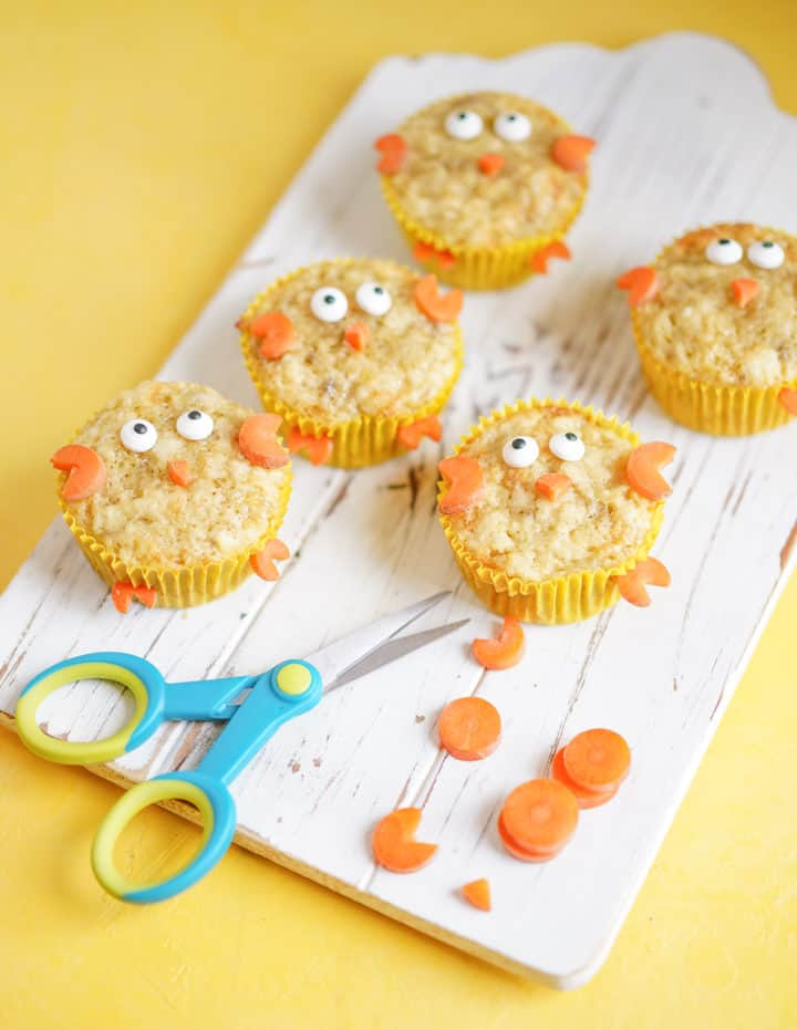 several chick muffins with scissors and carrots to show