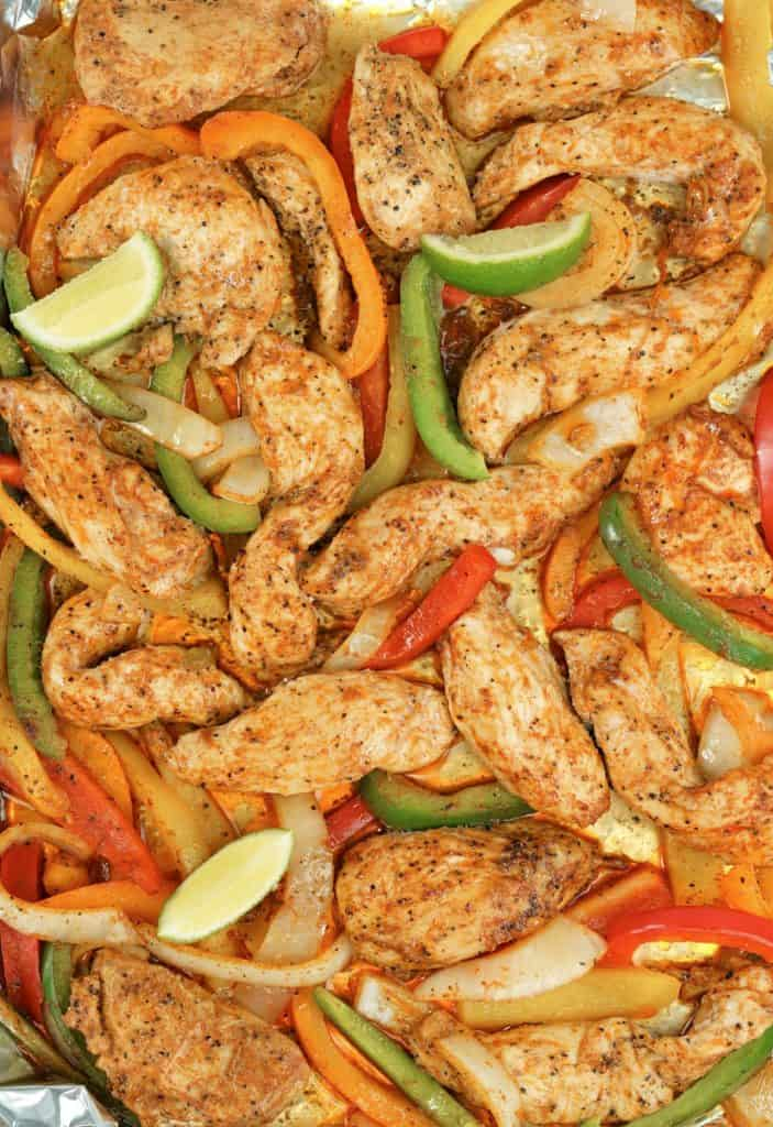 close up of chicken fajitas in a pan with bell peppers