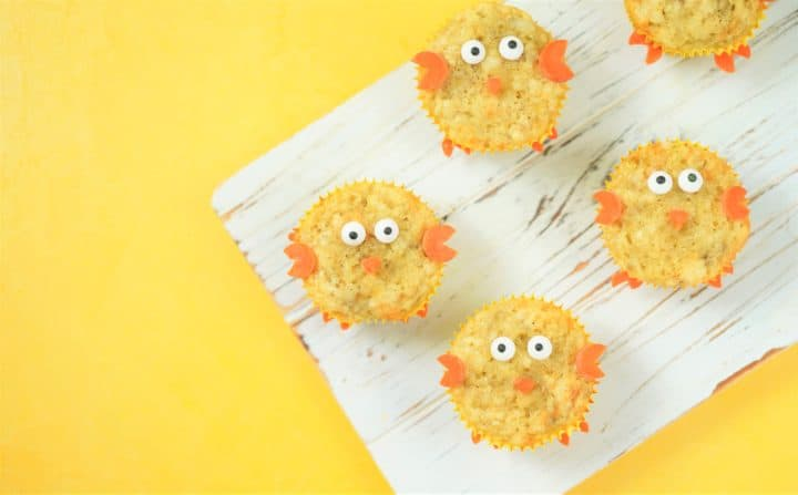 three chick muffins on white board on yellow background