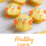 Chick decorated cupcakes on wooden board