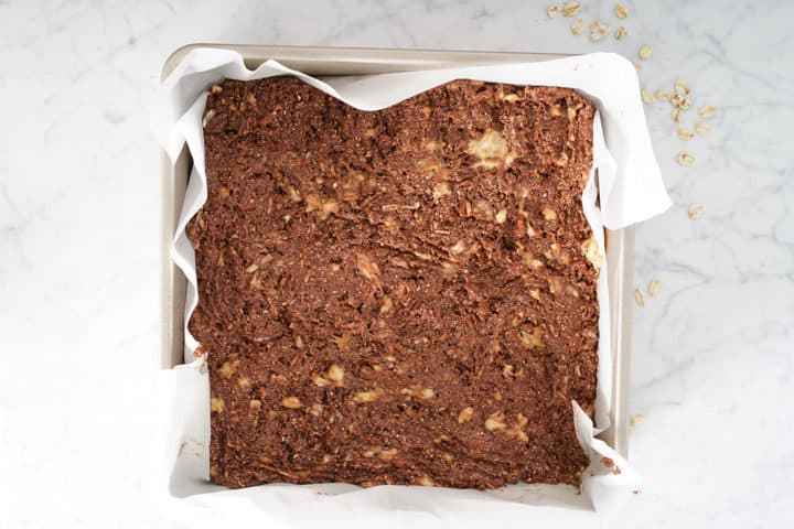 Square pan of chocolate mixture lined with parchment paper