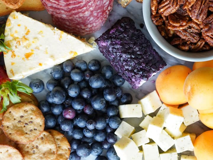 Close up of fruit and cheeses