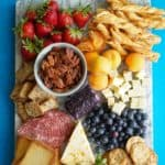 Board with snacks on a blue background