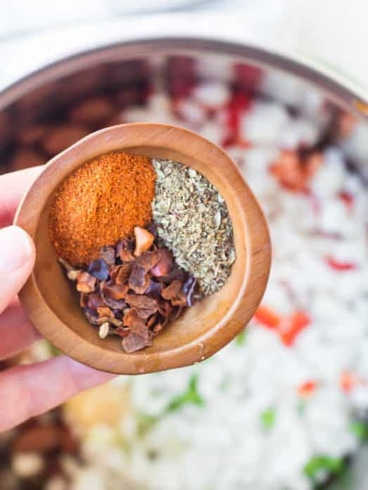 close up of spices in a wooden bowl
