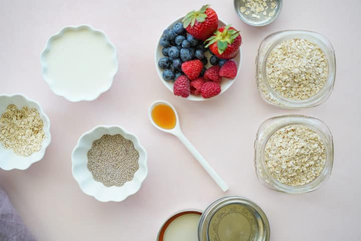 Bowls of ingredients, chia seeds, milk, fruit, oats honey