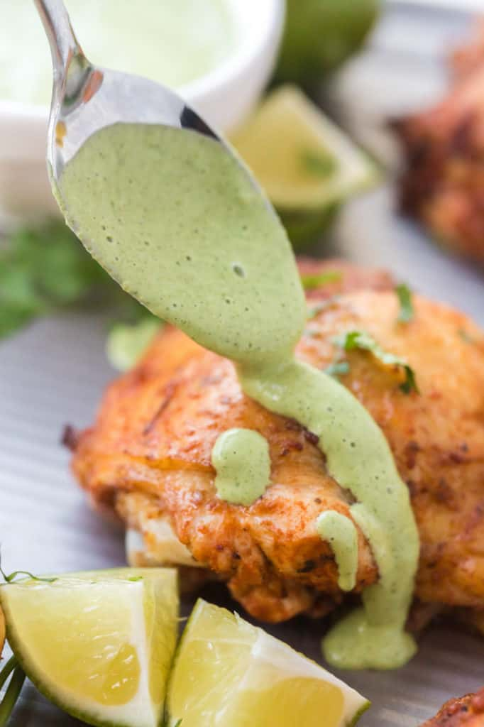 Chicken with green sauce being poured on