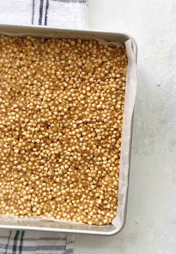Pan of pressed millet cereal mixture