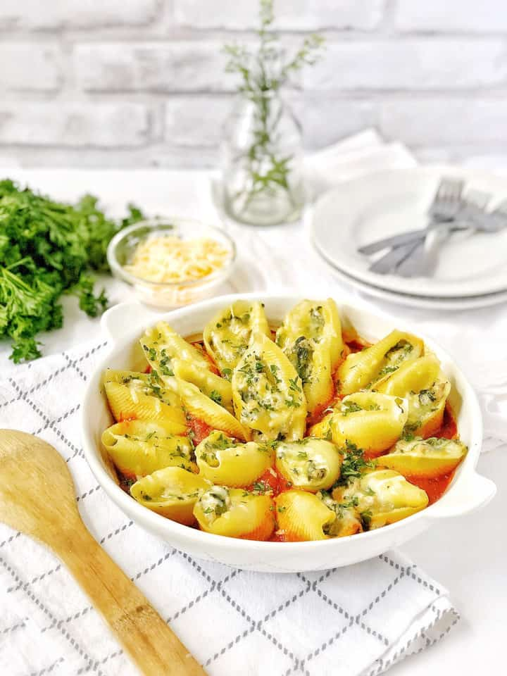 Bowl of stuffed shells with utensils