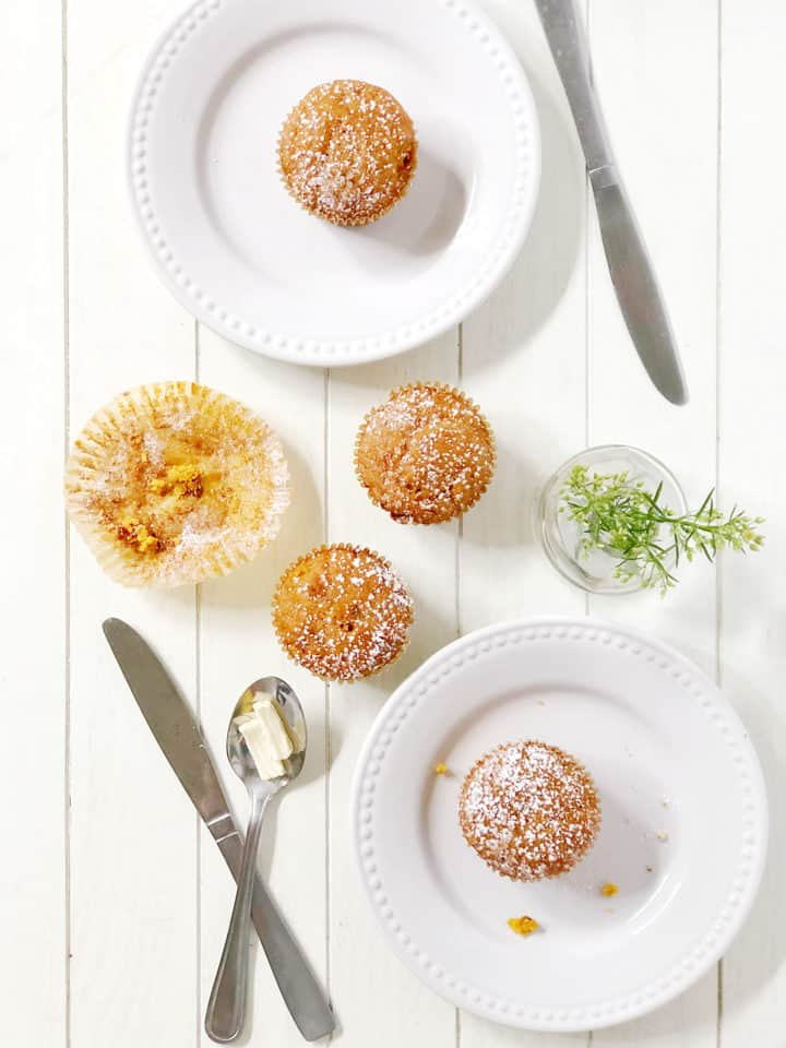 Flat lay of muffins with utensils and plates