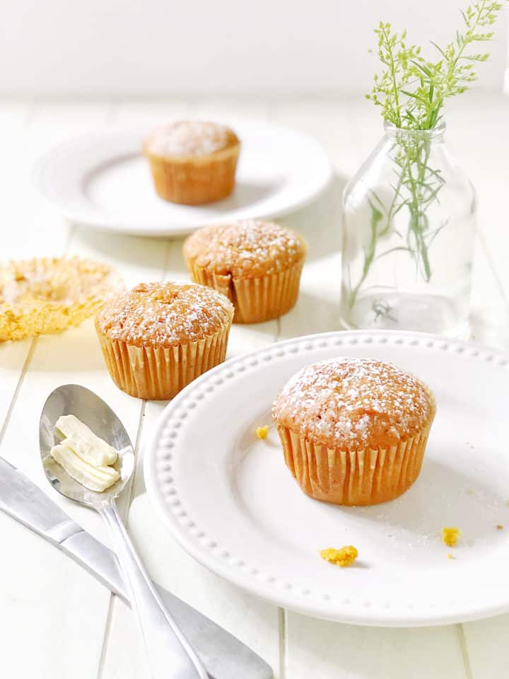 Muffins on a plate and spoon of butter