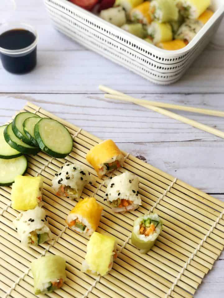 cut sushi on a bamboo mat with chopsticks