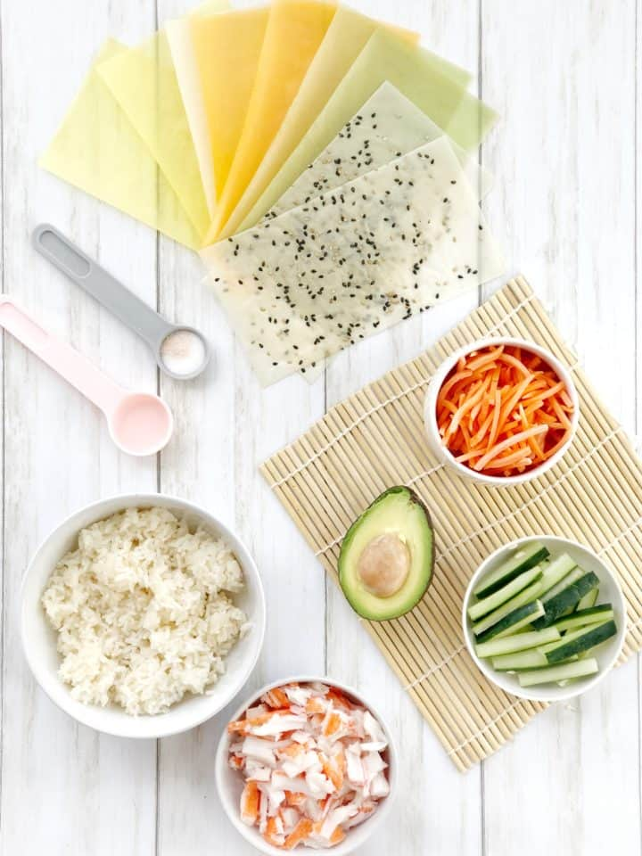 array of vegetables and sushi wrappers, rice and crab