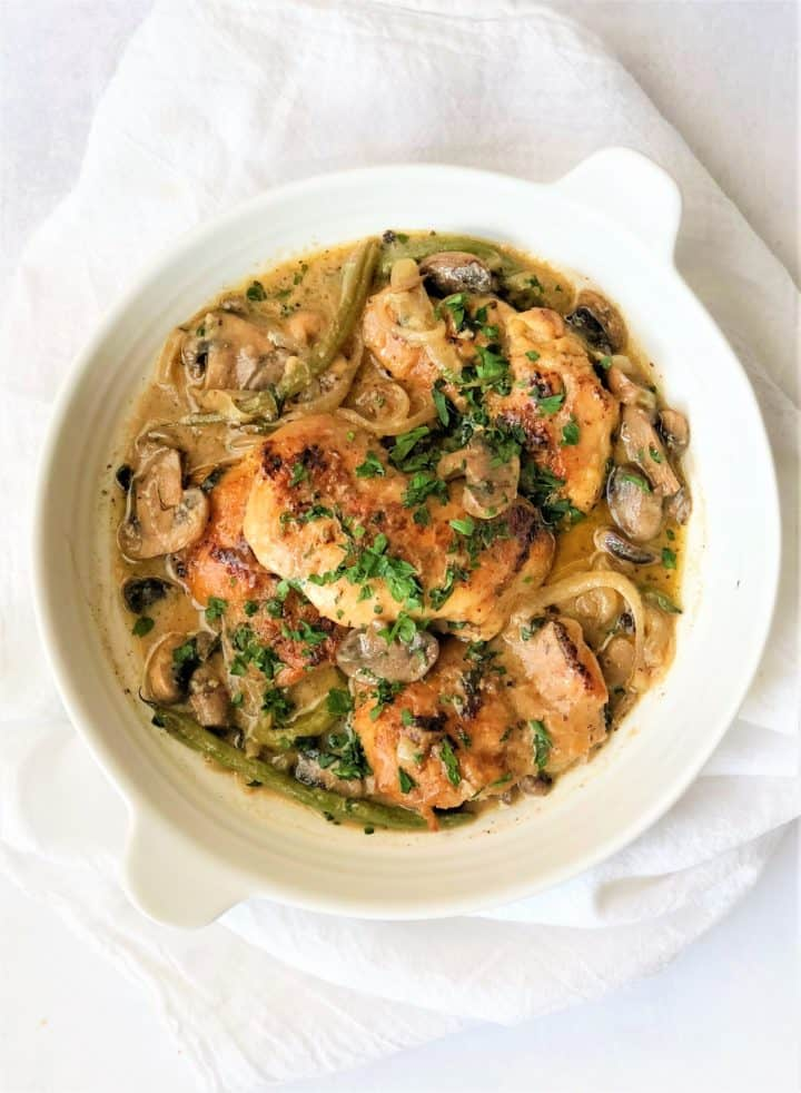 bowl of chicken marsala with onions and mushrooms