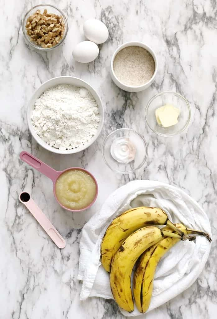 Flat lay photo of bananas flour, applesauce and other ingredients