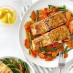Plate of salmon on top of vegetables