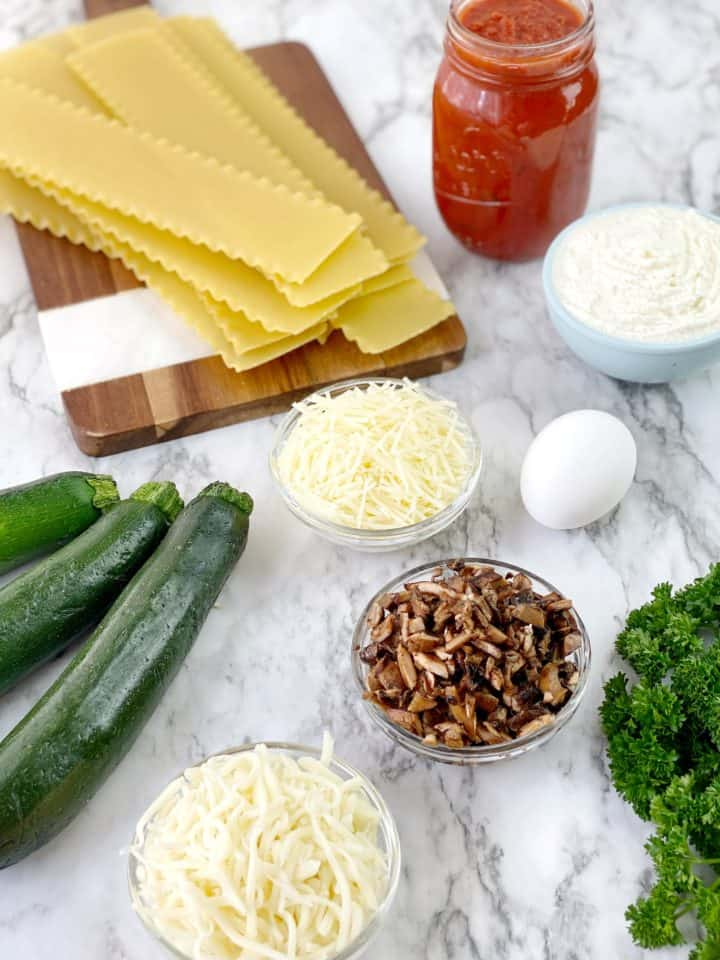 ingredients including lasagna noodles, egg, zucchini, cheese