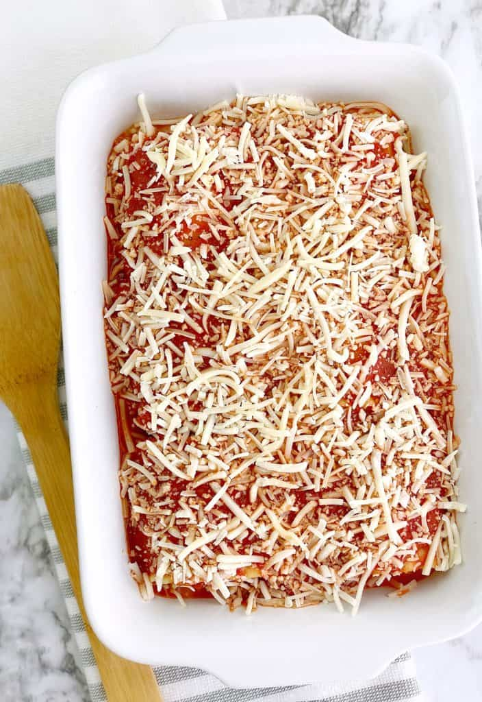 baking dish with red sauce and mozzerella cheese on top