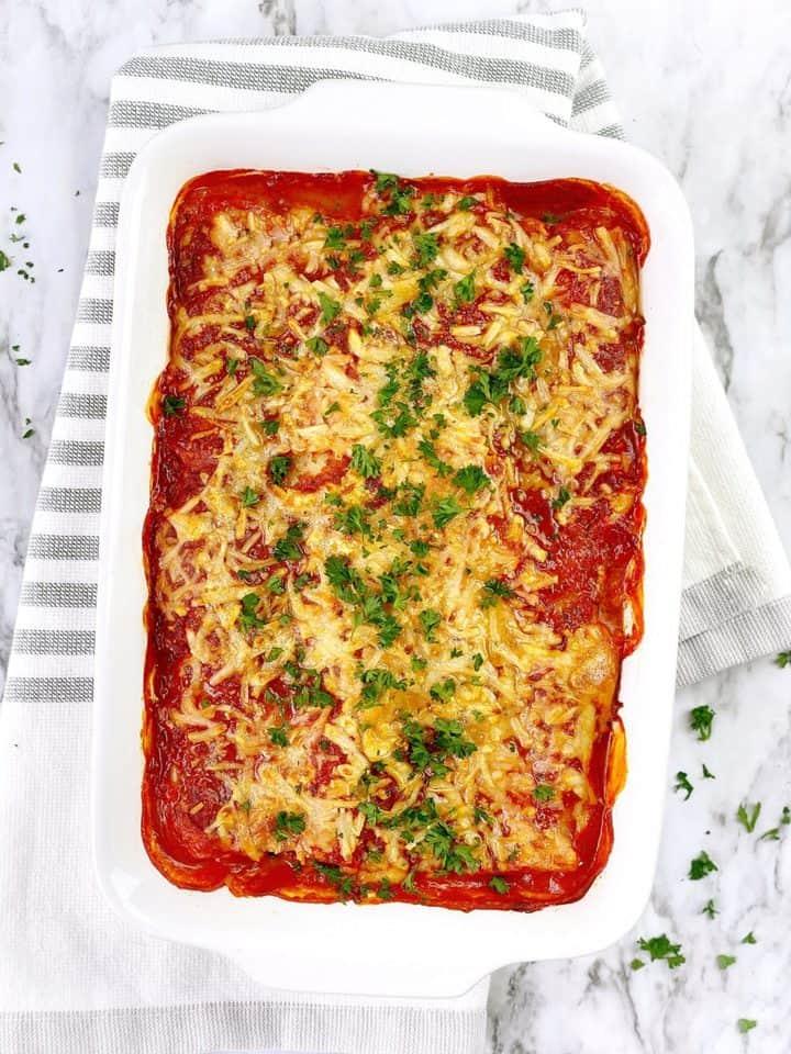 lasagna with pasta sauce and garnish