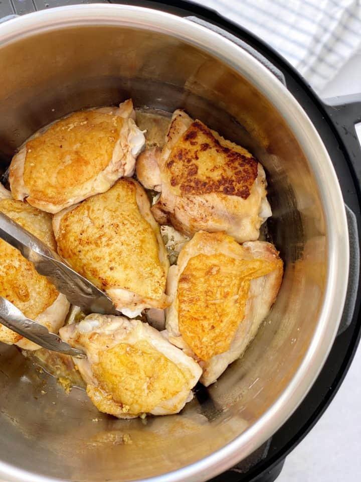 instant pot with chicken in it medium brown
