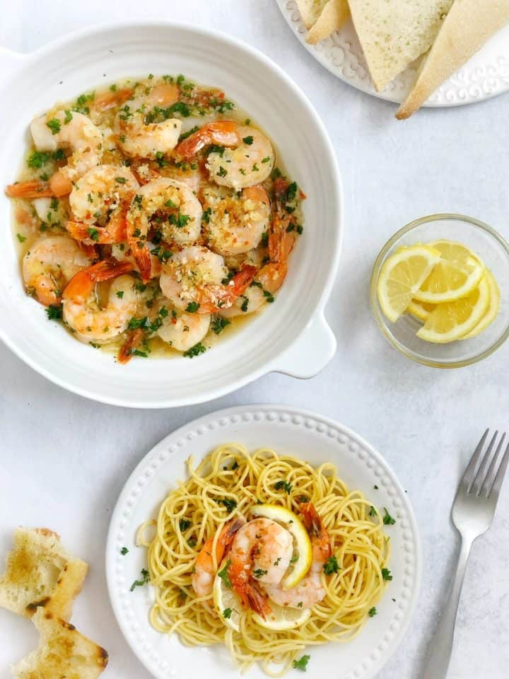 easy shrimp scampyi with lemon and pasta on the side