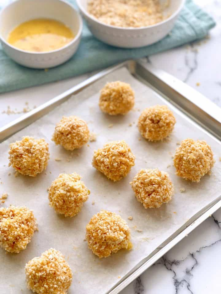 prepared mac and cheese balls on a baking sheet