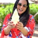 woman in red shirt with doll whip ice cream