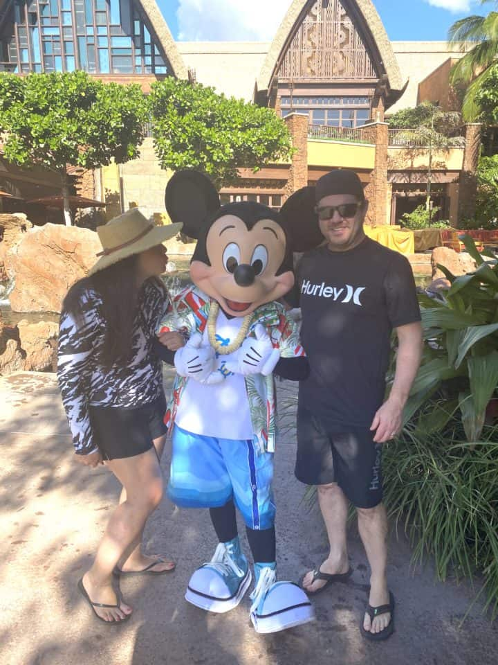 man and woman next to mickey character