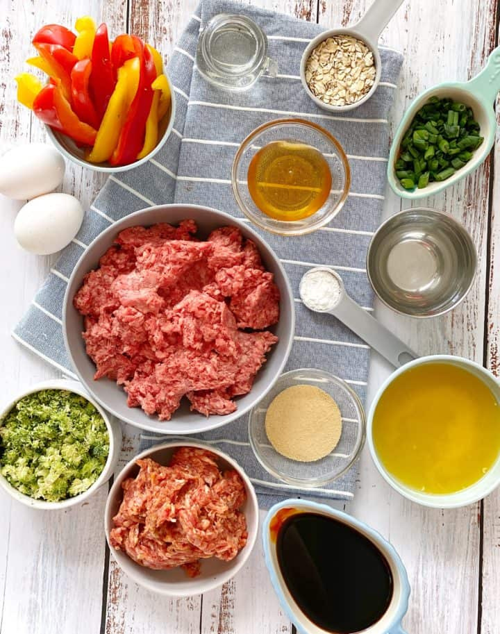 over the top shot of ingredients inclding ground meat, broccoli, oats