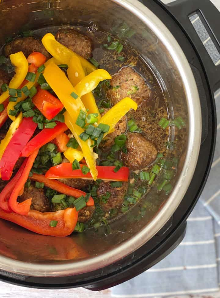 instant pot with meatballs and bell peppers