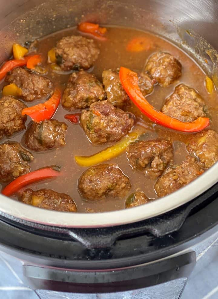 instant pot with meatballs in brown sauce