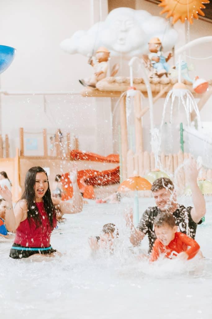 family in water splashing
