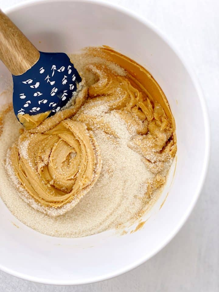 bowl of peanut butter and sugar and egg