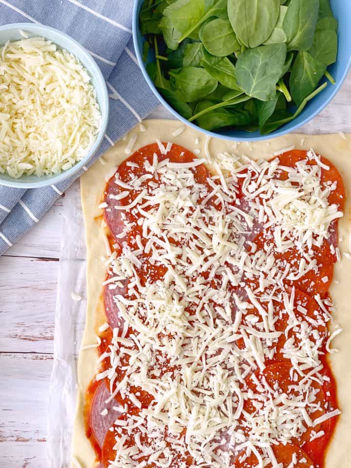 pizza dough with cheese and marinary