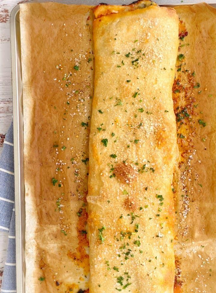 cooked stromboli on baking sheet