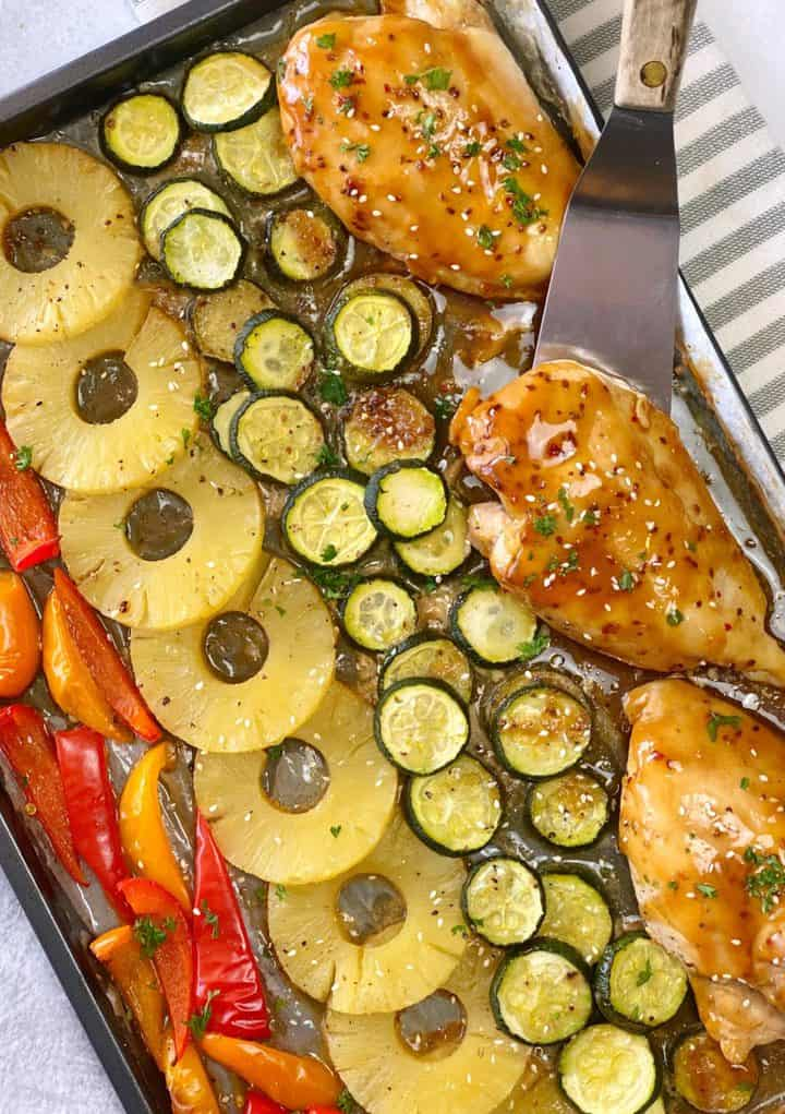 sheet pan of chicken, pineapples, zucchini, and bell peppers